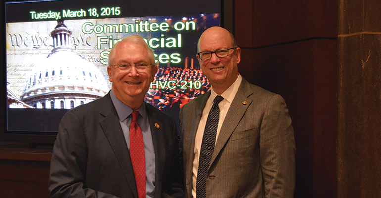 Texas community banker David Williams meets with Rep. Randy Neugebauer (R-Texas) after testifying on excessive regulation before the House Financial Services Committee.