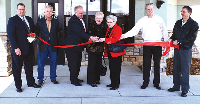 Pictured left to right: John Gill, president of Citizens Alliance Bank; Philip Forstrom, chairman of Citizens Alliance Bank; Mark Paulson, administrator of the Chippewa County—Montevideo Hospital; ribbon-cutting-event guests Alvina Munneke, Joan Gaebe and Paul Gaebe; and Gordy Woltjer, superintendent of Chester Construction.