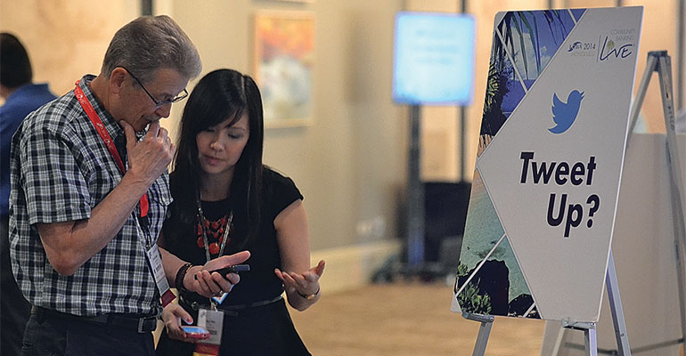 Ann Chen helps community banker Jim Kramer of Altura State Bank in Rochester, Minn., during a tweet-up at last year's ICBA national convention in Hawaii.