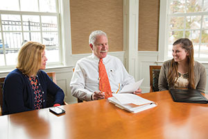 Musing Over Marketing—Eric Morse talks marketing and branding issues with colleagues Julie White, Needham Bank's assistant vice president-business development (left), and Erica McLaughlin, the bank's marketing officer.
