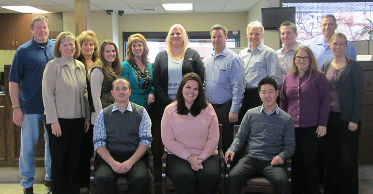 All Together—Utah Community Bank's employee team is comprised of 15 people. Front row (from left): Travis Rigby, Teralea Monroe and Moses Sohn. Middle row (from left): Julie Hirschi, Kyra Reynolds, Robin Burger and Ingvild Potter. Back row (from left): Jeff Loosle, Sherry Loosle, Quanette Shinsel, Augusta Hawkins, Javvis Jacobson, Kent Landvatter, Matt Coleman and Bruce Nordgren.