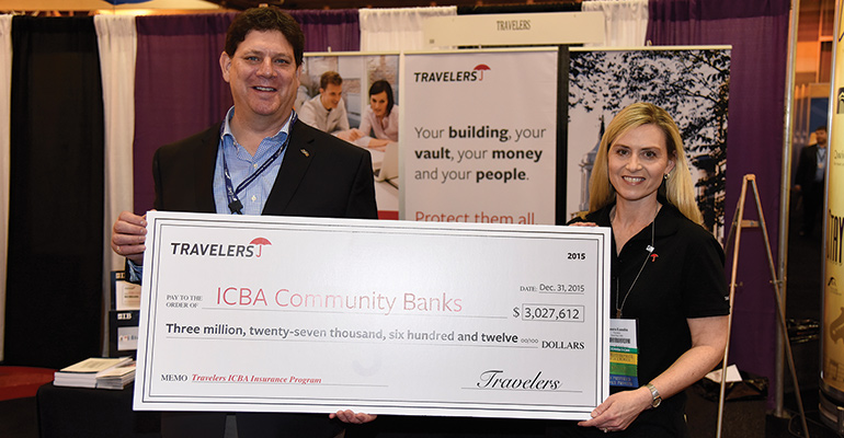 Big Savings—ICBA's Dan Clancy and Travelers' Laura Lundin hold a big check representing the $3 million dividend paid this year to community banking participating in the ICBA-Travelers property-and-casualty insurance Preferred Service Provider program.