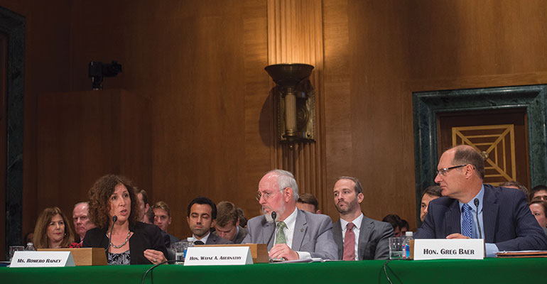 Speaking Out—ICBA Chairman Rebeca Romero Rainey (far left) testified in June before the U.S. Senate Banking Committee. She explained why lawmakers should exempt community banks from Basel III capital rule.