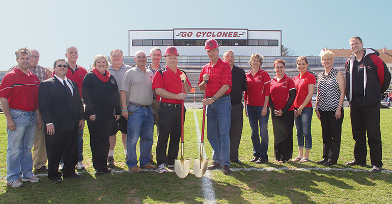Spade Work—Todd Langenfeld (center left) helps community leaders break ground on renovations to a local high school sports field and stadium.