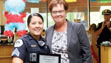 woman giving an officer an award