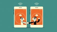 two smart phones shaking hands