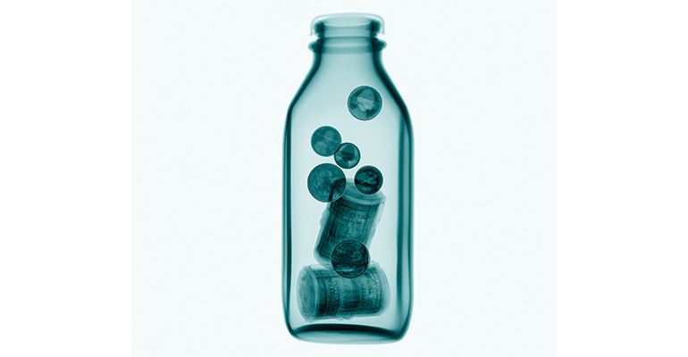 glass milk bottle with money in it
