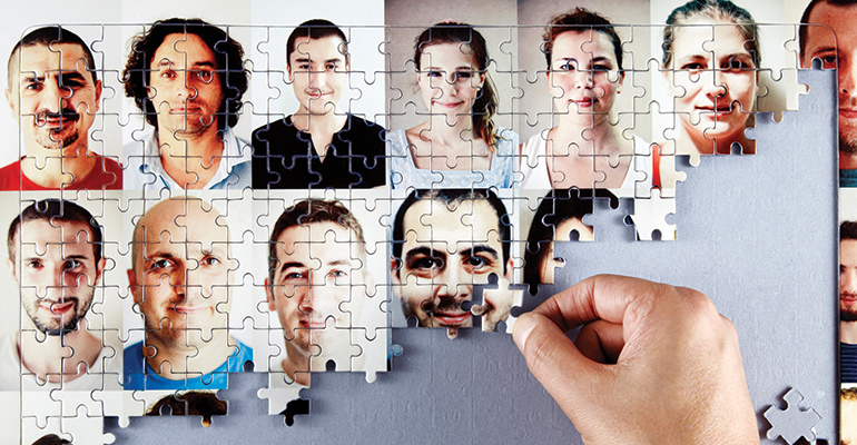 Puzzle being put together of peoples faces