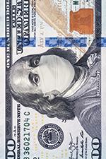 100 dollar bill with a mask