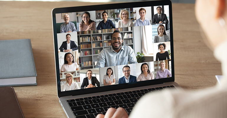 Person in a virtual meeting on a laptop