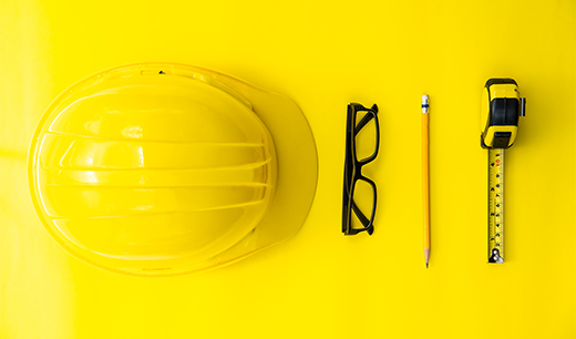 hardhat, glasses, pencil and tape measure