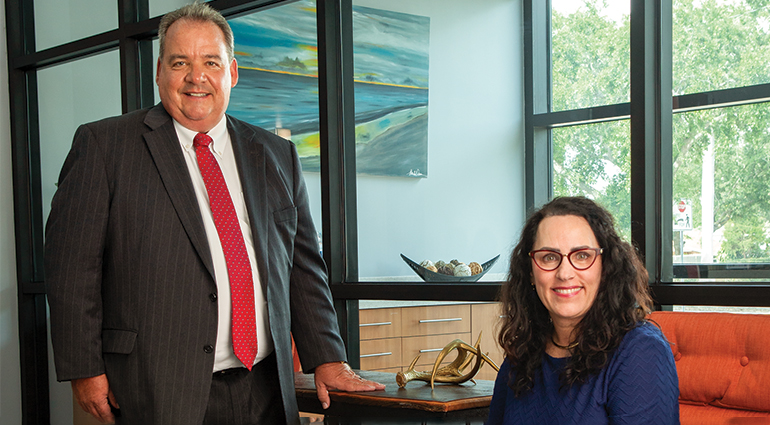 First Home Bank's executive vice president Thomas G. Zernick of First Home Bank and Amy Thomas, practice manager at Gayoso Plastic Surgery