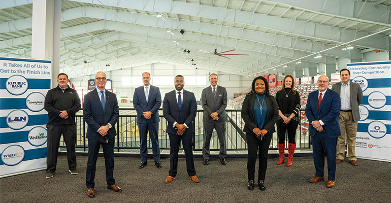 Louisville Urban League president and CEO Sadiqa Reynolds and local bank officials at the Norton Healthcare Sports & Learning Center in Louisville, Ky.